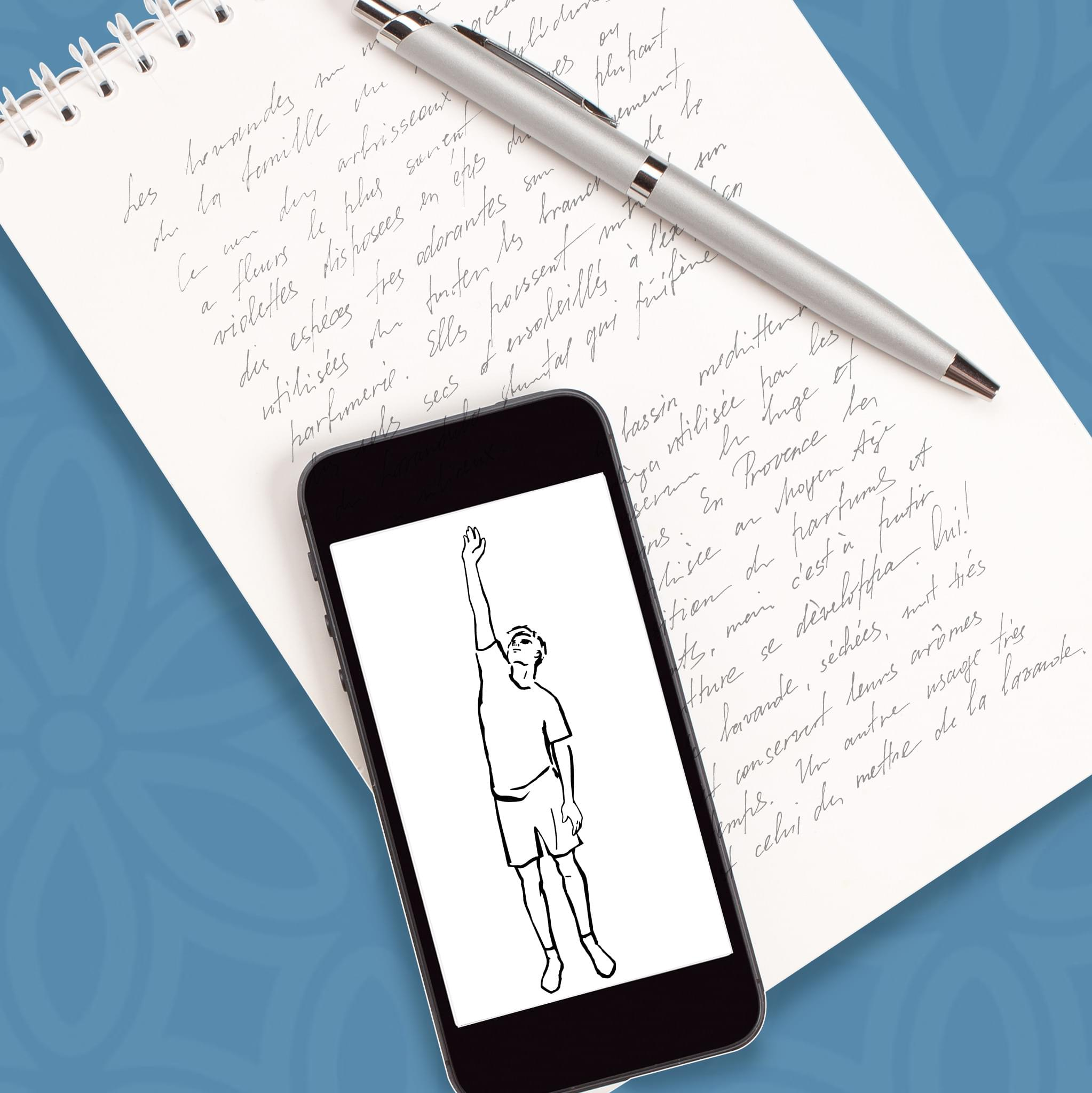 Writing and iPhone device with yoga pose